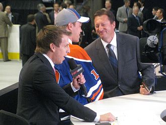Taylor Hall - Taylor Hall with Steve Tambellini and James Duthie at the 2010 NHL Entry Draft