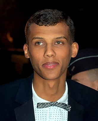 Mulatto - Stromae, a popular musician, has Rwandan father and Belgian mother.