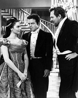 Jack Ging - Ging as Beau McCloud (center) with Suzanne Lloyd and Howard Keel in TV's Tales of Wells Fargo, 1961