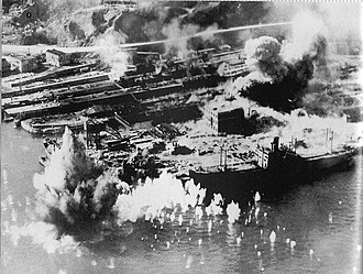Manufacturing in Hong Kong - Taikoo Dockyard under a US air raid during the Second World War.