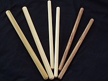 Different types of drum sticks for taiko, called bachi, are displayed flat on a surface.