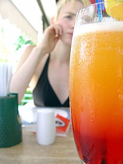 Tequila Sunrise with girl behind.jpg
