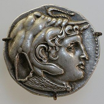 Ptolemaic coin showing Alexander wearing an elephant scalp, a symbol of his conquest in India Tetradrachm Ptolemaeus I obverse CdM Paris FGM2157.jpg