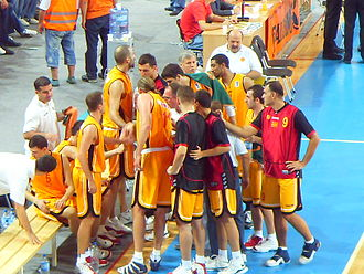 Macedonia national basketball team - Macedonia basketball team at a time out during a match with Latvia.