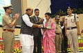 The Union Home Minister, Shri Rajnath Singh presenting the Police Medal for Gallantry on the occasion of the Valour day of Central Reserve Police Force, in New Delhi.jpg
