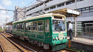 Toei 7700 series - Green-liveried 7701 in July 2016