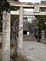 Torii and Stele in front of Kashii Shrine.jpg