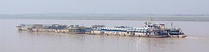 Towboat and mixed cargo barges on the Chang Ji...