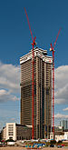 Tower 185 during construction phase on a sunny afternoon.jpg