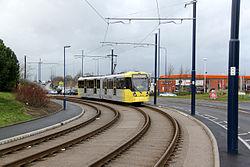 Tram approaching Ashton terminus, geograph 3808817 by Alan Murray Rust.jpg