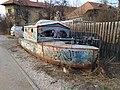 Tuzla - Abandoned boat in a street (2019).jpg