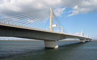 a structure that combines the main elements of both a prestressed box girder bridge and a cable-stayed bridge
