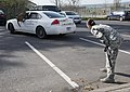 U.S. Air Force Staff Sgt. Shannon Hennessy, a military working dog handler with the 52nd Security Forces Squadron (SFS), instructs Katya, a military working dog with the 52nd SFS, to enter a vehicle to subdue 140319-F-NJ596-137.jpg