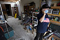 U.S. Air Force Tech. Sgt. Rhonda Stockstill, a surgery technician with the 72nd Medical Group stationed at Tinker Air Force Base, Okla., talks to her husband, not shown, in what remains of their home in Moore 130527-F-IE715-037.jpg