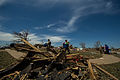 U.S. Airmen help a resident search through debris in the wake of a tornado in Moore, Okla., May 22, 2013 130522-F-RH756-263.jpg