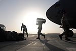 U.S. Marines assigned to Marine Medium Tiltrotor Squadron 266 unload their gear from a C-17A Globemaster III aircraft assigned to Joint Base Charleston, S.C., Aug. 23, 2010, at Camp Bastion, Afghanistan 100823-F-RR679-065.jpg