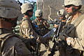 U.S. Marines with Bravo Company, 1st Battalion, 5th Marine Regiment go over their patrol route at Forward Operating Base Blue Falcon before a security patrol through Nawa district, Helmand province, Afghanistan 090822-M-VO695-002.jpg