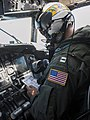 U.S. Navy Lt. Bryan Peterson, assigned to Fleet Logistics Support Squadron (VRC) 30, conducts pre-start checks on a C-2A Greyhound aircraft before conducting a functional check flight at Naval Air Station North 130827-N-HF270-046.jpg