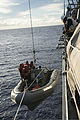 U.S. Sailors assigned to the guided missile destroyer USS Preble (DDG 88) lower a rigid-hull inflatable boat from the ship during a man overboard exercise in the Philippine Sea Aug. 15, 2013 130815-N-TX154-052.jpg