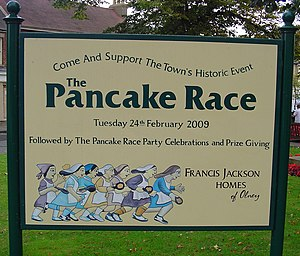 Olney, Buckinghamshire - Signpost advertising 2009 Pancake Race