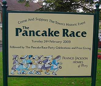 Olney, Buckinghamshire - Signpost advertising 2009 Pancake Race