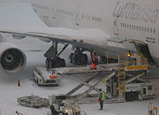 Baggage loading of a Lufthansa Boeing 747 during a temporary closure due to heavy snow falls