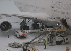 Loading luggage at Boston Logan Airport, during a temporary closure due to heavy snow falls