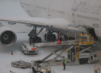 Logan International Airport - Cargo loading of a Lufthansa Boeing 747-400 during a temporary closure due to heavy snowfall