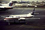 USAir Express Metro N2719H at LGA (15562148403).jpg