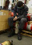 USS Bonhomme Richard Sailor refills a self-contained breathing apparatus 141204-N-ET721-001.jpg