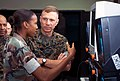 US Navy 030416-M-9902V-027 Gen. Michael W. Hagee, Commandant of the Marine Corps (CMC), discusses the adventures that Marines have while conducting the Medium Tactical Vehicle Replacement-Training Simulator with Cpl. Amina Welc.jpg