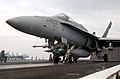 US Navy 030417-N-4953E-004 An Aviation Boatswain's Mate signals the shooter that the launch bar is in place.jpg