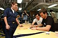US Navy 030827-N-8273J-002 The rock bank Blink-182 Singer, bass guitarist Mark Hoppus and singer, guitarist Tom DeLonge sign autographs prior to a United Services Organization (USO) show aboard USS Nimitz.jpg