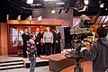 US Navy 040325-N-7822B-031 Sailors assigned to Naval Station Everett, accompanied by Kristi Keene, the Everett Mall marketing director, take part in a televised public service announcement.jpg