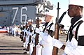 US Navy 040615-N-4616B-006 The Honor Guard rifle team aboard USS Ronald Reagan (CVN 76) present arms during the playing of the national anthem, at a memorial service held for former President Ronald Reagan.jpg