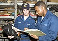 US Navy 040810-N-1238B-025 Machinist's Mate 3rd Class Kenny Jackson conducts an inventory with Fireman Horace Berlin.jpg