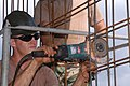 US Navy 040914-N-2970T-029 Builder 3rd Class Mark Dyas, assigned to Naval Mobile Construction Battalion One Three Three (NMCB-133), Detail Sasebo, slices through a steel reinforcement bar.jpg