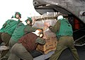 US Navy 050106-N-9214D-114 Marines assigned to the Combat Cargo division aboard the amphibious assault ship USS Bonhomme Richard (LHD 6), load pallets of bottled water into a Marine CH-46E Sea Knight helicopter.jpg