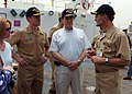 US Navy 050129-N-8629M-116 U.S. Ambassador to the Republic of Singapore, the Honorable Frank Lavin, (center), receives a tour of the Military Sealift Command hospital ship USNS Mercy (T-AH 19).jpg