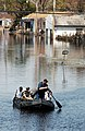 US Navy 050906-N-6436W-249 U.S. Navy Sailors assigned to the dock landing ship USS Tortuga (LSD 46) search flooded New Orleans neighborhoods for survivors of Hurricane Katrina.jpg