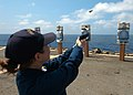 US Navy 060316-N-7526R-015 Ensign Erin Choromanski, fires a 9mm pistol at a target during small arms familiarization training on the flight deck aboard the amphibious command ship USS Blue Ridge (LCC 19).jpg