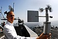 US Navy 070305-N-9928E-119 Aerographer's Mate 3rd Class Eric Wohlander uses a hand-held angomameter to measure relative winds in order to calculate true wind speed.jpg
