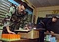 US Navy 070617-N-1467K-002 Lt. j.g. Orlando Rivera and Lt. j.g. Natalie Derfus organize medication at the Taviran Elementary School during a medical civil assistance program (MEDCAP). Rivera and Derfus, attached to Naval Medica.jpg