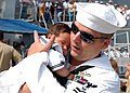 US Navy 070703-N-6403R-006 A Sailor aboard guided-missile destroyer USS Nitze (DDG 94) meets his newborn baby boy on the pier at Naval Station Norfolk.jpg