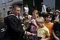 US Navy 070924-N-4649C-002 Gas Turbine System Technician (Mechanical) 1st Class David Ballesteros, of Arleigh Burke-class guided-missile destroyer USS Lassen (DDG 82), hands out toy cars to children at the Mayak Children's Reha.jpg