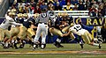 US Navy 071201-N-0989H-724 U.S. Naval Academy quarterback, Midshipman Troy Goss, attempts to fend off a tackle from the Black Knights' Defensive Back.jpg