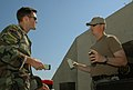US Navy 080611-N-3289C-061 Lt. Matthew Coombs and Chief Explosive Ordnance Disposal Technician Kenneth Lee, assigned to Explosive Ordnance Disposal Mobile Unit (EODMU) 8 Det. Europe, discuss how to prepare C4 explosives.jpg