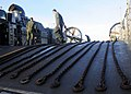 US Navy 080621-N-5067K-122 Crewmembers of a landing craft air cushioned clean the craft and stow retaining chains after disembarking vehicles and equipment from elements of the 31 MEU that were embarked aboard USS Harpers Ferry.jpg
