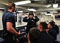 US Navy 080730-N-1488S-018 Midshipman 3rd Class Myrian Smith dons tactical gear designed for visit, board, search, and seizure operations.jpg