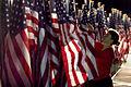 US Navy 080910-A-7377C-021 Lorin Pfiel, a Healing Field Foundation volunteer, arranges an American flag Sept. 10, 2008, in the Pentagon parking lot.jpg